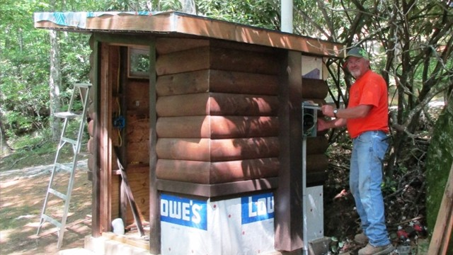 Gary Ball Building Rustic Privy for Campground